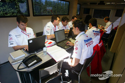 Toyota team members work in the Toyota motorhome
