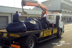 Juan Pablo Montoya's wrecked car back on the rescue truck