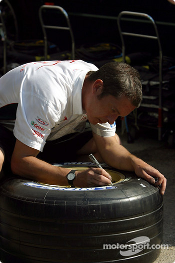 Jaguar team member prepares the tires