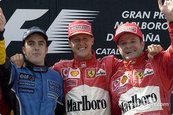 The podium: race winner Michael Schumacher with Fernando Alonso and Rubens Barrichello
