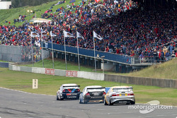Jamie Whincup leads Rodney Forbes and Paul Weel down pit straight