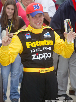 Race winner Ed Carpenter celebrates victory