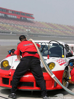 The Rennwerks crew practices a pitstop.