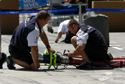Williams-BMW team members prepare refueling equipment