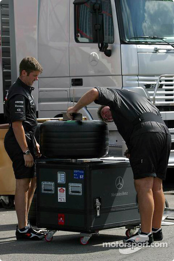 McLaren team members work on tires