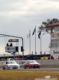 Valvoline Racing Garth Tander and Stone Bros Russell Ingall head down pit straight during qualifying