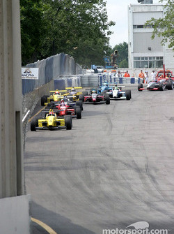 A.J. Allmendinger leads the field through the Duplessis Gate