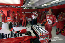 Michael Schumacher watches qualifying