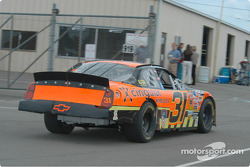 Robby Gordon heads to the garage for more adjustments