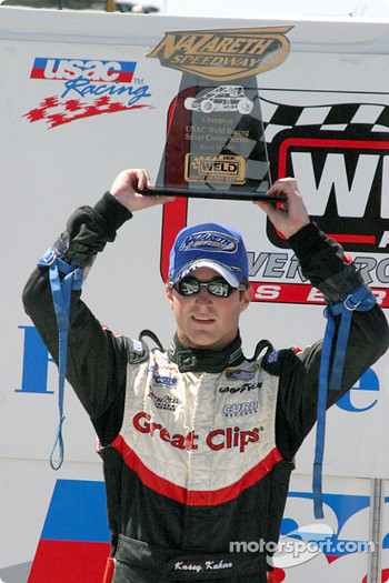 Kasey Kahne proudly displays his trophy