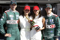 Justin Wilson and Mark Webber with the lovely Mumm girls