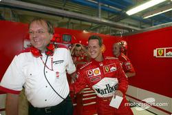 Michael Schumacher celebrates pole position