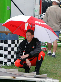 Biker Steve Johnson waits to race in the rain
