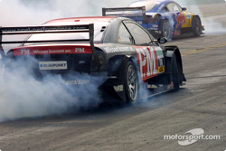 Timo Scheider and Mattias Ekström smoke the tires