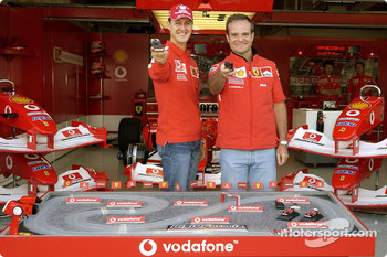 Michael Schumacher and Rubens Barrichello play DigiQFormula