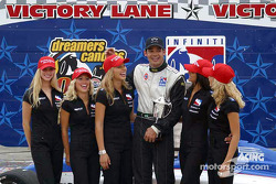 Victory lane: race winner Thiago Medeiros with the IndyGirls