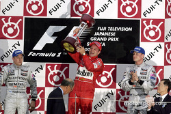 Podium: race winner Rubens Barrichello with Kimi Raikkonen and David Coulthard