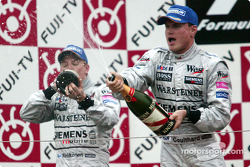 Podium: champagne for Kimi Raikkonen and David Coulthard