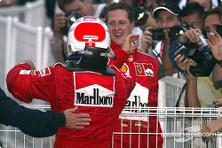 Rubens Barrichello and Michael Schumacher celebrate