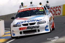 Jamie Whincup pushes his Commodore through the Esses