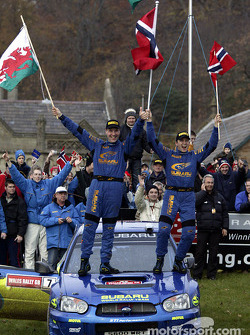 Petter Solberg and co-driver Phil Mills celebrate WRC title