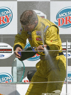 Podium: champagne for A.J. Allmendinger
