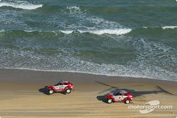 Stéphane Peterhansel and Jean-Paul Cottret, Hiroshi Masuoka and Gilles Picard cruise to a 1-2 finish on the beach of Dakar