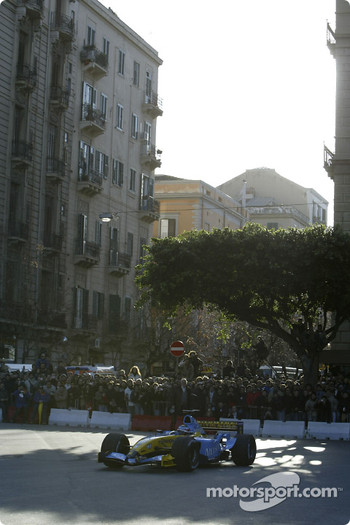 Fernando Alonso does a demonstration run in front of the fans in Palermo