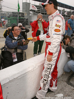 Kevin Harvick signs autographs