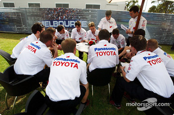 Toyota engineers have a meeting in the paddock