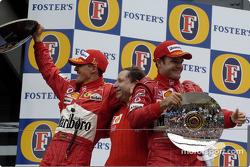Podium: race winner Michael Schumacher, Jean Todt and Rubens Barrichello celebrate