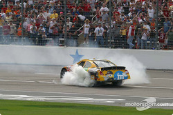 Race winner Elliott Sadler smokes the tires