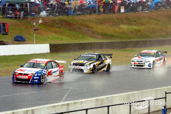 Rick Kelly, Craig Lowndes and Garth Tander cross the line after the red flag was brought out by officials