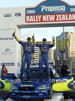 Podium: winners Petter Solberg and Phil Mills celebrate victory