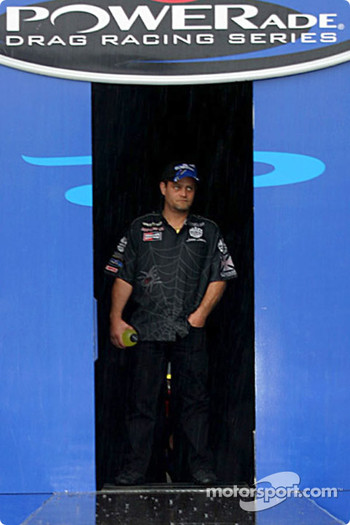 Scott Kalitta really did not want to come out in the rain for introductions