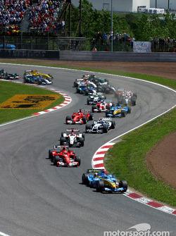 First corner: Jarno Trulli leads Michael Schumacher