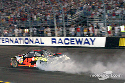 Jamie McMurray leaves the crash with a cloud of smoke