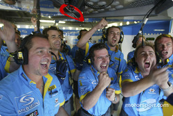 Renault team members celebrate Jarno Trulli's pole position