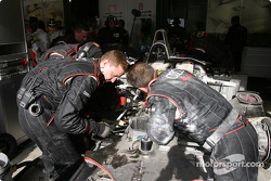 Audi Sport UK Team Veloqx crew work on the damaged suspension of the #8 Audi R8