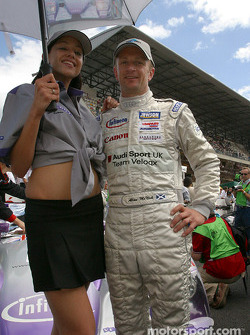Allan McNish with the Audi Sport UK Team Veloqx girl