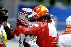 Takuma Sato and Michael Schumacher celebrate