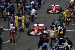 Rubens Barrichello and Michael Schumacher arrive on the starting grid