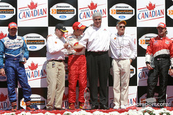 Podium: race winner Sébastien Bourdais with team owners Carl Haas and Paul Newman, and Jimmy Vasser and Patrick Carpentier