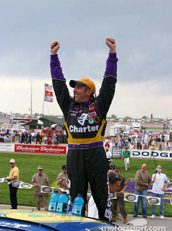 Greg Biffle celebrates the victory