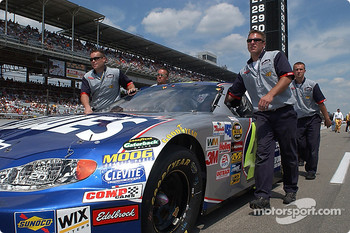 Jimmy Johnson's crew pushes the #48 onto the grid