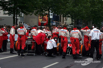 Panasonic Toyota Racing team members prepare the TF104