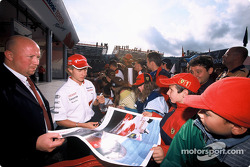 Ryan Briscoe signs autographs