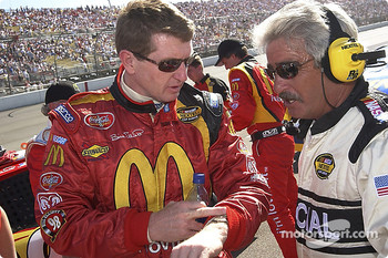 Bill Elliott chats with a NASCAR official before the race