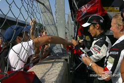 Takuma Sato signs autographs after the race