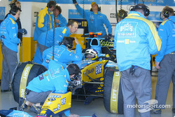 Jacques Villeneuve and Renault F1 team members get ready for the day ahead